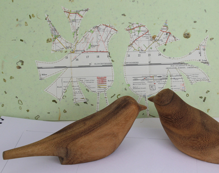 Stitched-map-and-wooden-birds