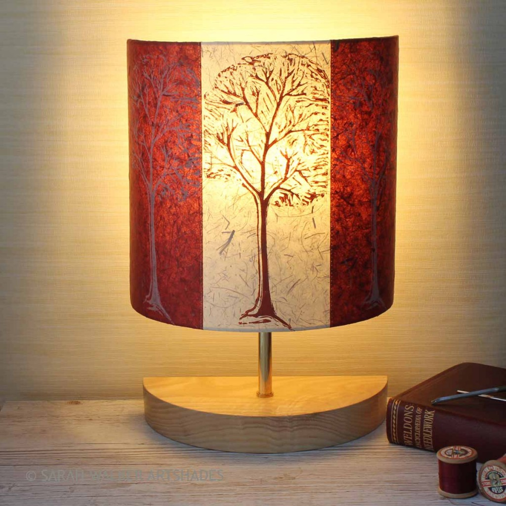 Table lamp with handprinted trees design